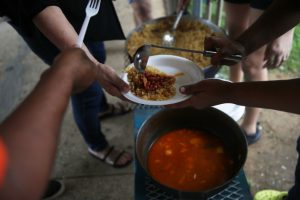 volunteer communal pot of food