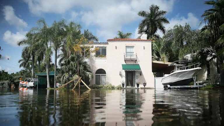 A Home Is Surrounded By Floodwater